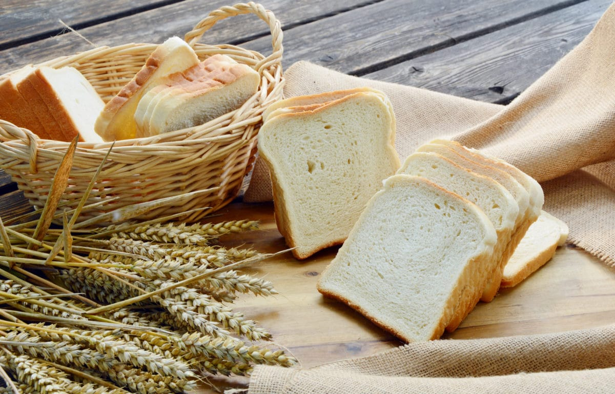 white bread in a basket and on a table