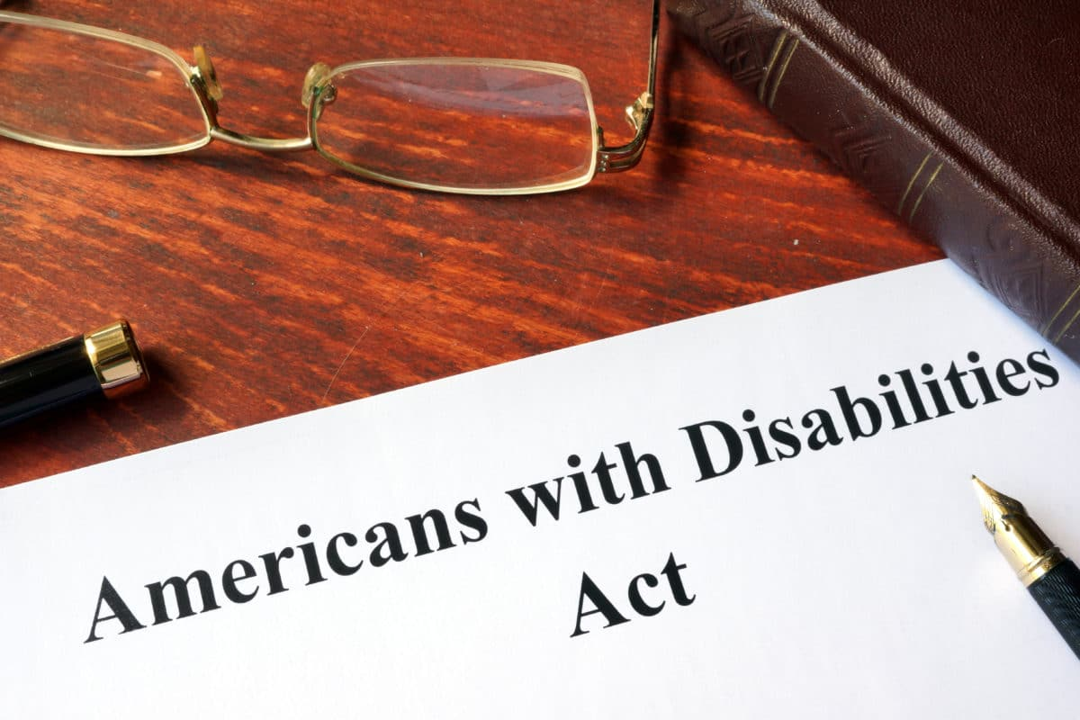 Best Podcasts on Chronic Pain paper on desk about American Disabilities Act